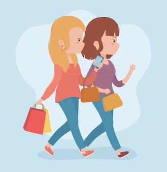 Mujeres hermosas caminando con teléfonos inteligentes