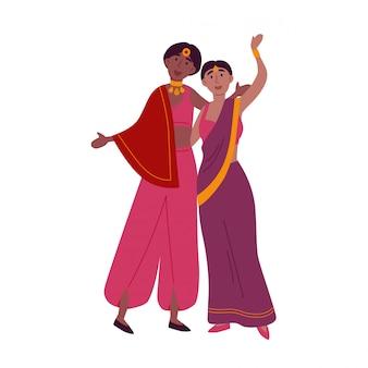 Mujeres indias en sari tradicional bailando danza nacional