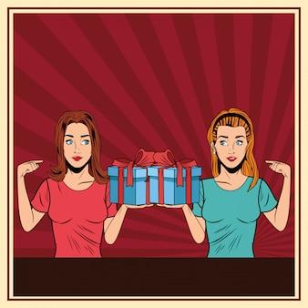 Mujeres jóvenes con una caja de regalo de arte pop.