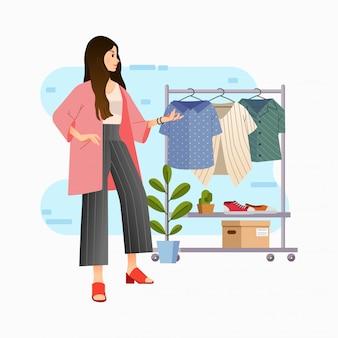 Mujeres jóvenes con estilo moderno elegir blusa en el armario