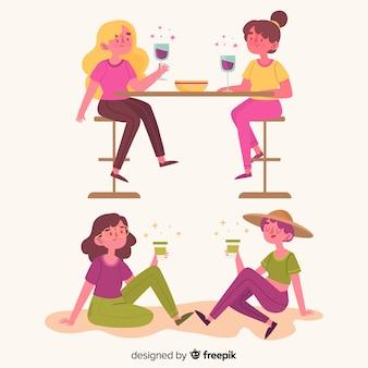 Las mujeres jóvenes pasan tiempo juntas con bebidas