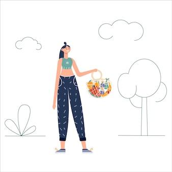 Mujeres jóvenes que llevan bolsas eco naturales con compras. cuidando el medio ambiente, cero desperdicio, vegetarianismo ,. compras de comestibles ecológicas, canasta de compras amigable reutilizable con verduras y frutas