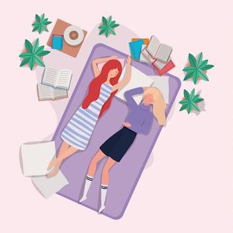 Mujeres jóvenes relajándose en un colchón en el dormitorio