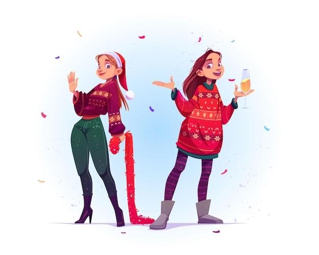 Mujeres jóvenes con suéteres feos celebran la navidad y el año nuevo