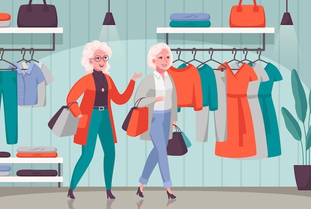 Las mujeres mayores disfrutan comprando juntos composición con personas mayores que eligen ropa en los grandes almacenes