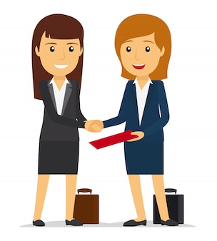 Mujeres de negocios dándose la mano