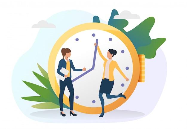 Mujeres de negocios moviendo las manecillas del reloj por delante