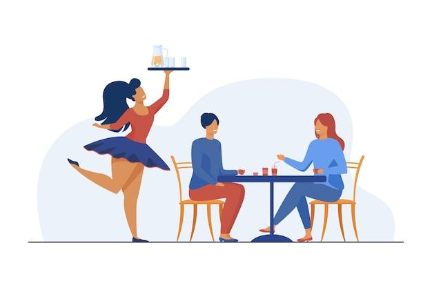Mujeres que descansan en el restaurante.