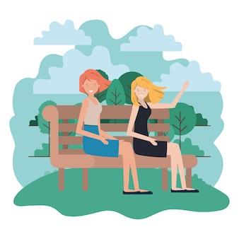 Mujeres sentadas en la silla del parque con un personaje de avatar de paisaje