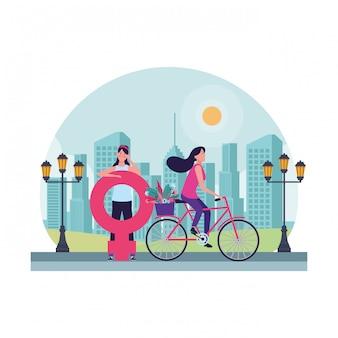 Mujeres con símbolo femenino y bicicleta