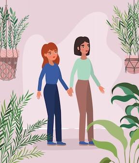 Mujeres tomados de la mano hojas y plantas