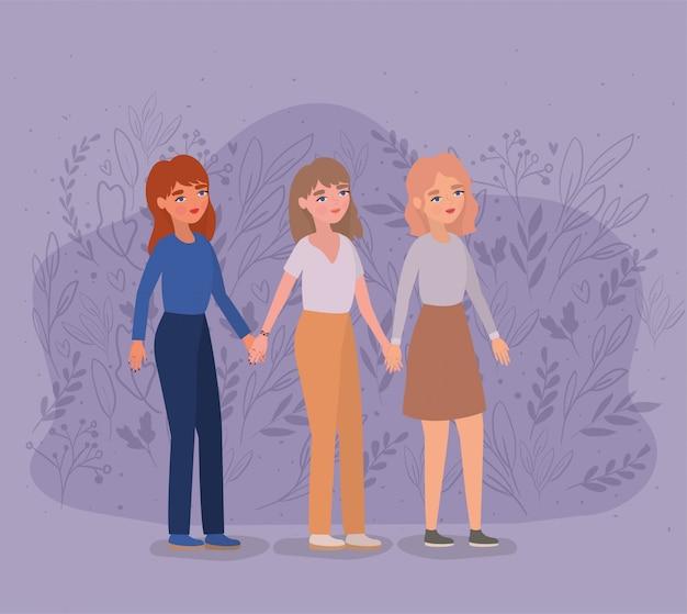 Mujeres tomados de la mano en el parque y las hojas