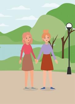 Mujeres tomados de la mano en el parque