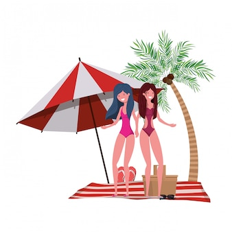 Mujeres con traje de baño en la playa y sombrilla.