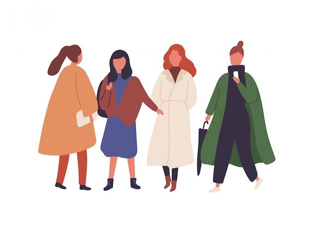 Mujeres en trajes de temporada de otoño ilustración plana. chicas con estilo caminando juntos aislados en blanco. personajes femeninos en abrigos de moda de otoño. estudiantes, modelos en prendas de vestir de moda.