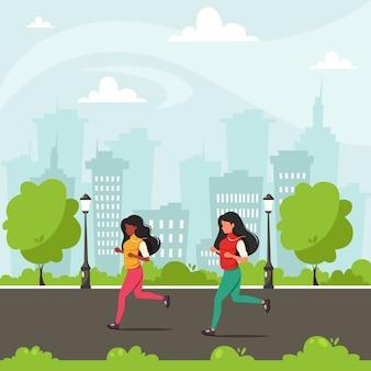 Mujeres trotando en el parque de la ciudad.
