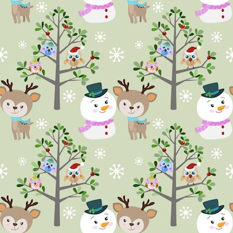Muñeco de nieve y ciervos lindos con el búho en invierno.
