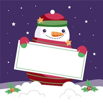 Muñeco de nieve navidad sosteniendo pancarta en blanco