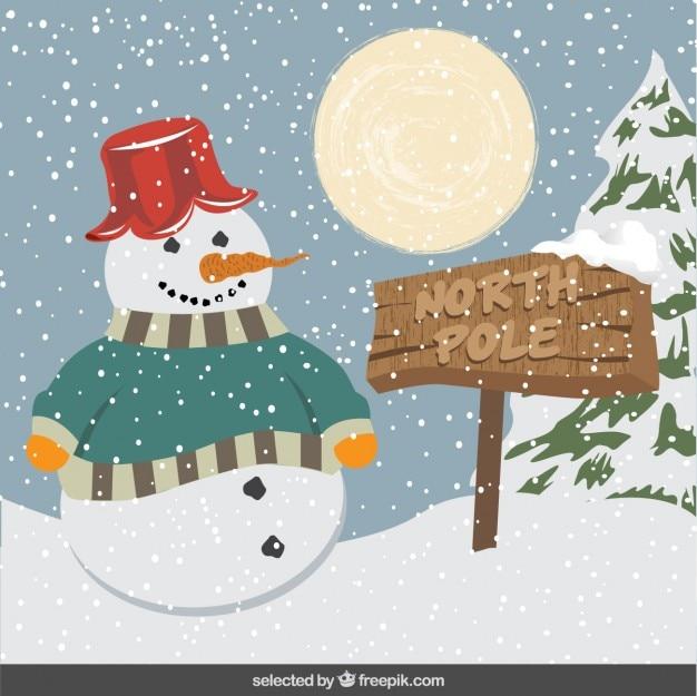 Muñeco de nieve en paisaje nevado