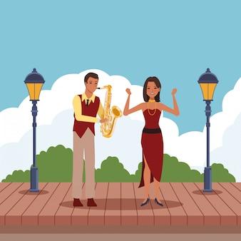 Músico tocando el saxofón y el bailarín
