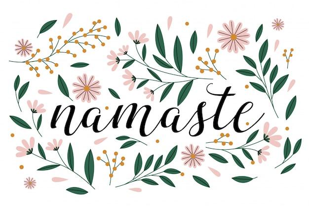 Namaste letras caligráficas con decoración floral.