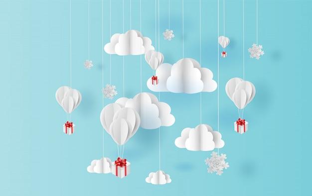 Navidad de globos y nieve flotando en el cielo