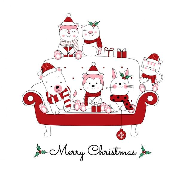 Navidad con el lindo animal de dibujos animados en el sofá