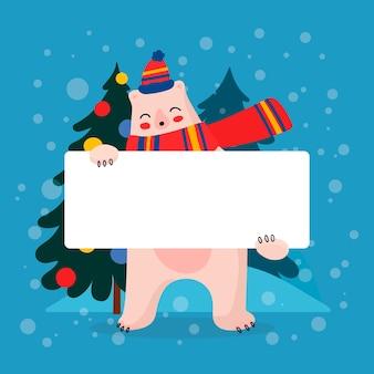 Navidad oso polar sosteniendo pancarta en blanco