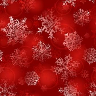 Navidad de patrones sin fisuras de copos de nieve en colores rojos