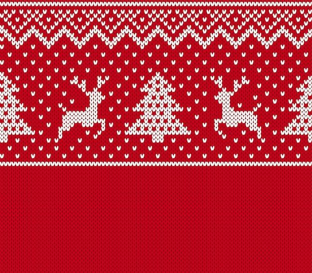 Navidad de patrones sin fisuras. estampado de punto con ciervo, árbol. fondo de suéter rojo. textura de navidad festiva