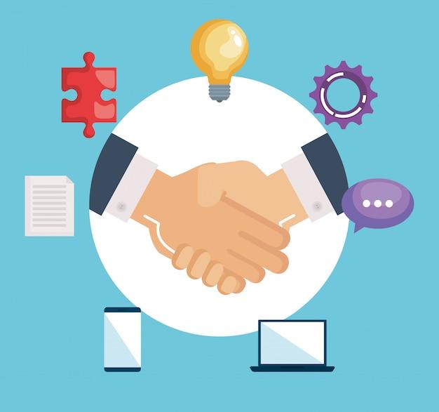 Negocio de apretón de manos con trabajo en equipo
