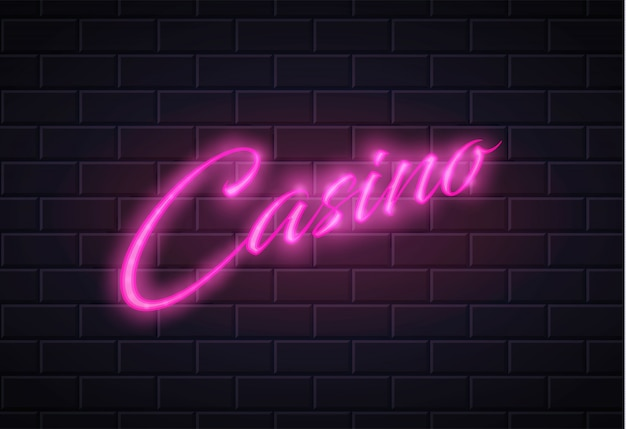 Neon casino poker card sign pared de ladrillo