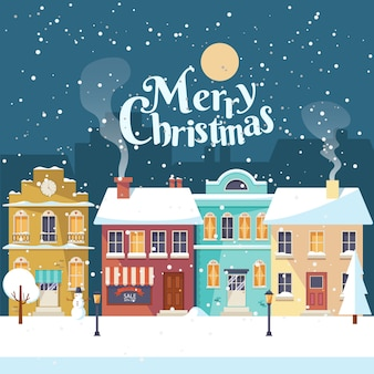 Nevado feliz noche de navidad en la acogedora tarjeta de felicitación de la ciudad