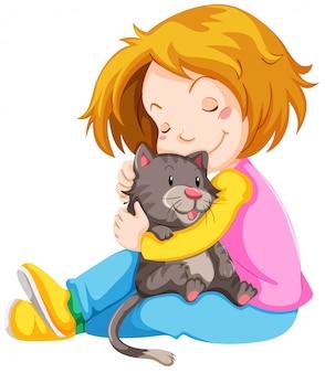 Niña abrazando lindo gatito