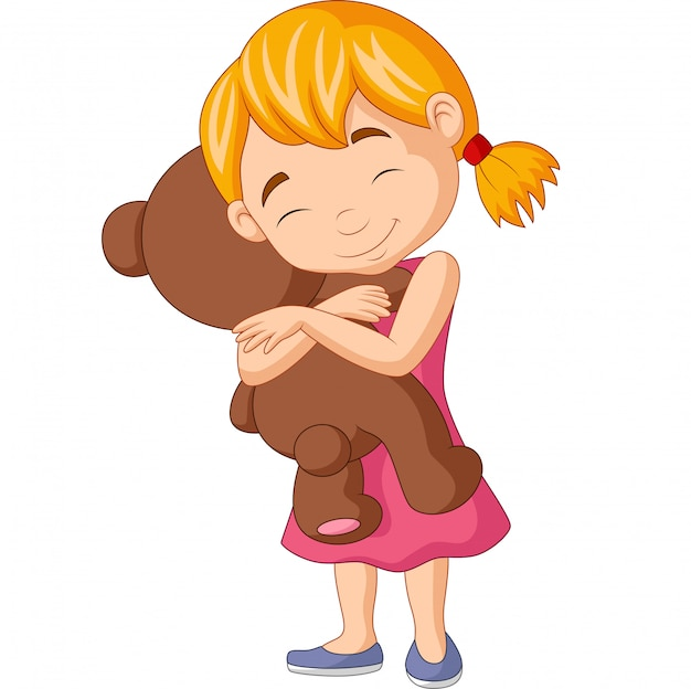 Niña abrazando el oso de peluche