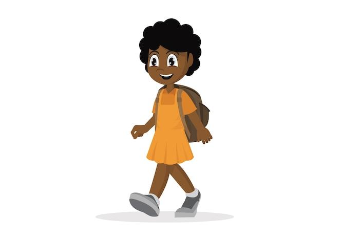 Niña africana con mochila caminando.