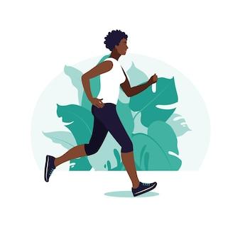Niña africana corriendo en el parque. mujer africana haciendo actividad física al aire libre en el parque, corriendo. concepto de fitness y estilo de vida saludable.