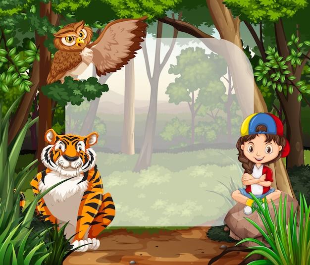 Niña y animales salvajes en la selva.