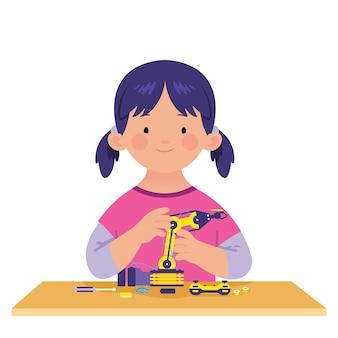 La niña aprende a hacer tecnología robot.