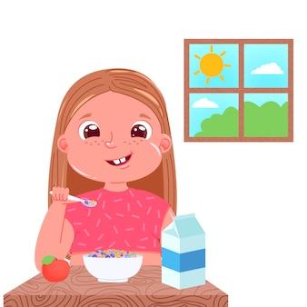 Una niña desayuna en la mañana. plato dulce copos de maíz de colores con leche.