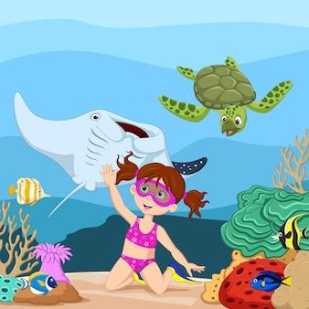 Niña de dibujos animados buceando en el mar tropical bajo el agua
