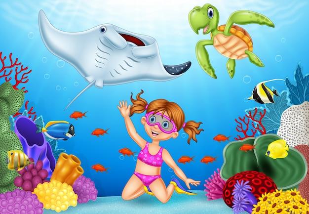 Niña de dibujos animados de buceo en el mar tropical bajo el agua