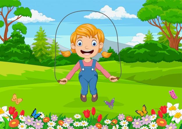 Niña de dibujos animados jugando saltar la cuerda en el parque