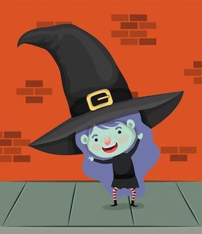 Niña con disfraz de bruja en el personaje de la pared