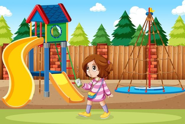 Una niña escuchando música en el parque.