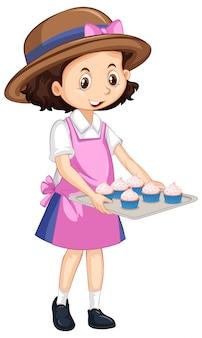 Una niña feliz con cupcakes en bandeja