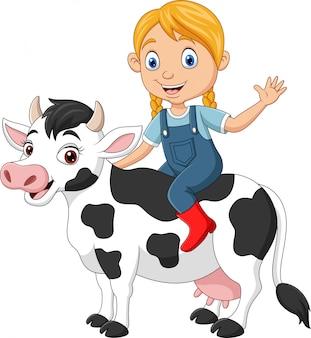 Niña feliz de dibujos animados montando vaca
