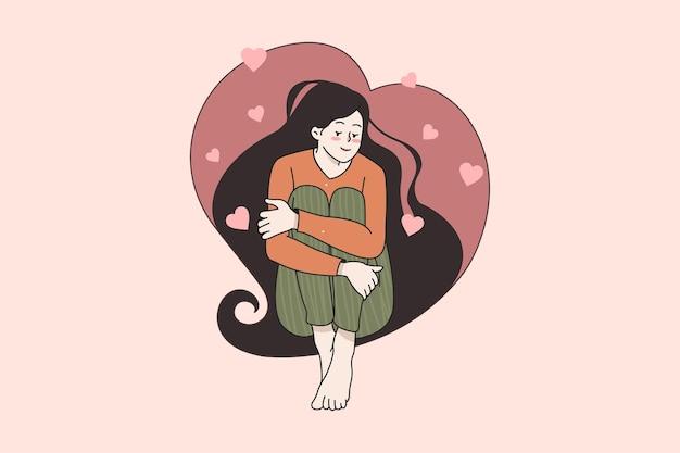 Niña feliz sentarse en el pelo en forma de corazón