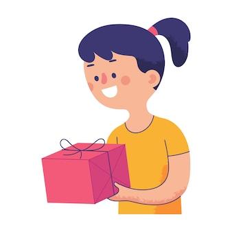Niña feliz sosteniendo un gran regalo en la mano