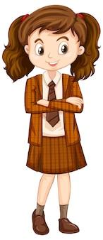 Una niña feliz en uniforme marrón